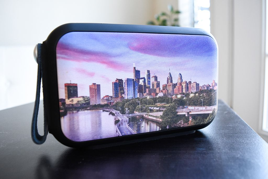 Speaker laminated with city background
