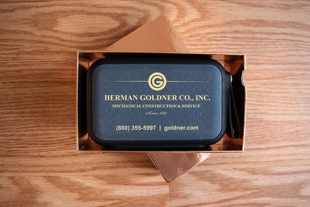 Speaker embroidered with Herman Goldner Logo